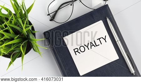 Stickers On The Notebook Text Royalty With Pen And Glasses On White Background
