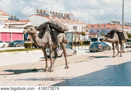 Evrenseki, Turkey - 03.16.2021 Element Of The Sculptural Composition Camel Caravan. Two Bronze Sculp