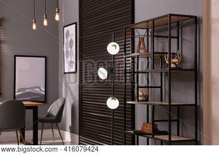 Stylish Shelving Unit With Decor Near Grey Wall Indoors. Interior Design