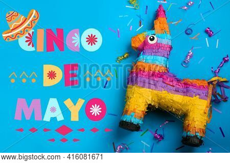 Cinco De Mayo Festive Poster. Bright Funny Pinata On Blue Background, Flat Lay