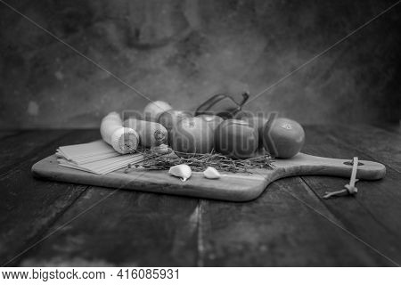 Different Ingredients For Cooking Italian Lasagna On A Wooden Background. Black And White High Quali