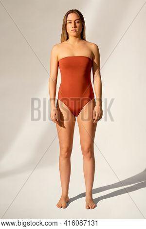 Strapless orange swimsuit women's summer apparel with design space full body