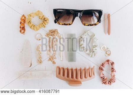 Modern Summer Accessories Layout. Golden Jewellery, Sunglasses, Hair Clips And Hairbands, Barrettes