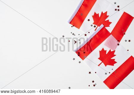 Happy Canada Day Banner Design. Canadian Flags And Confetti On White Background. Flat Lay, Top View,