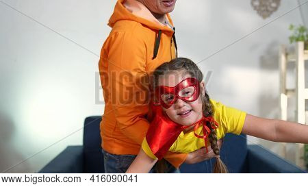 Dad Play Superhero With His Daughter. Feminism A Happy Family A Close-up Home Kid Dream Concept. Sup