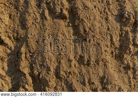 Textroy Of The Construction Sand. Building Material. Natural River And Quarry Sand. Beach Warm Sand.