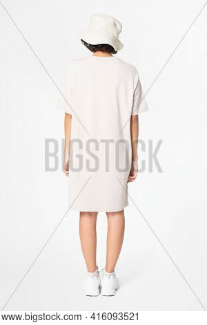 Woman in white t-shirt dress and bucket hat casual wear apparel