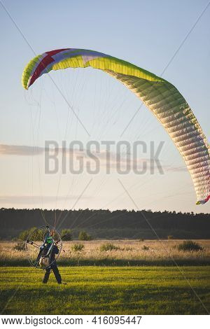 A Pilot With A Petrol Powered Backpack Landed And Folds The Wing. Flying With A Motorized Wing. Extr