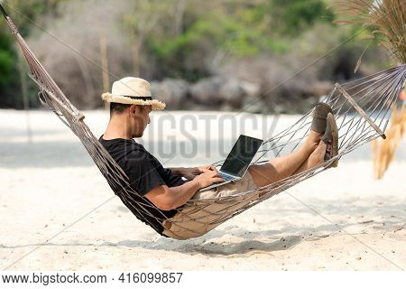 Lifestyle Freelance Man Relax And Sleeping On The Hammock After Using Laptop Working And Relax On Th