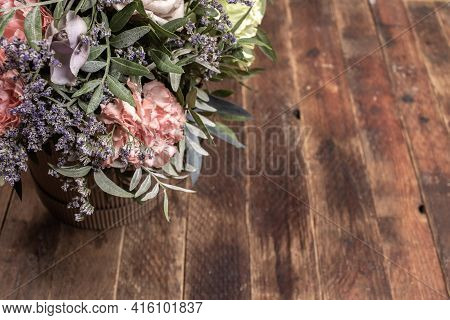 Retro Wooden Backdrop With Flowers Bouquet In Diy Cardboards Vase Close Up With Copy Space.