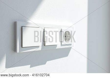 Modern White Switch Board With Two Switch And One European Plug. European Electrical Outlet. Selecti