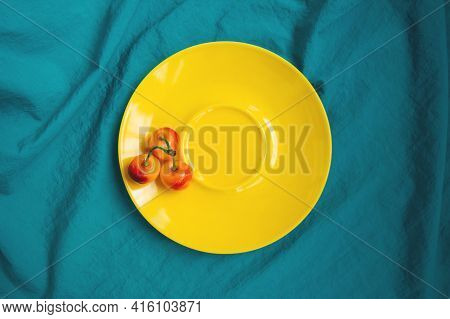 Sweet Cherry In Yellow Plate. Ripe Sweet Cherries On Yellow Plate On Turquoise Fabric Background. Re