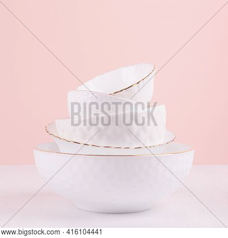 White Ceramic Crockery With Thin Gold Line, Textures In Elegant Soft Light Pink Interior On White Wo