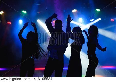 Party, Holidays, Celebration, Nightlife And People Concept - Group Of Happy Friends Dancing In Night