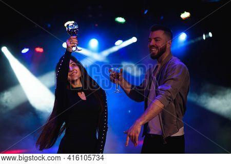 Young Stylish Couple Flirting In The Nightclub.