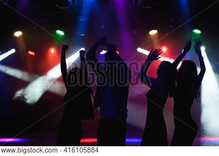 Party, Holidays, Celebration, Nightlife And People Concept - Group Of Happy Friends Dancing In A Nig