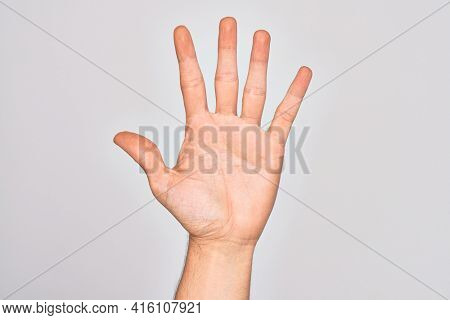 Hand of caucasian young man showing fingers over isolated white background counting number 5 showing five fingers