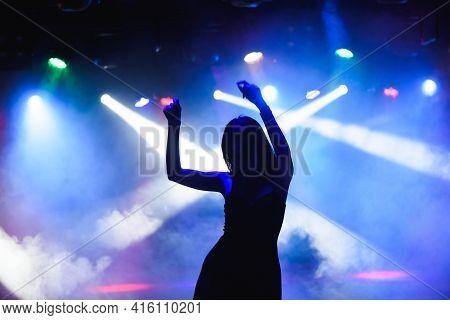 Dancing Silhouette Of Girl In A Nightclub.