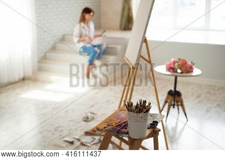 Concept Artist Beautiful Girl. Beautiful Women Are Creating Art. Young Artist Painting In The House.