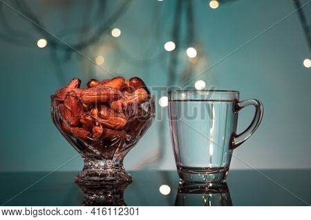 Close-up Of Muslim Iftar Of Breaking Of Fast During Ramadan Month With Preserved Sweet Dates And Wat