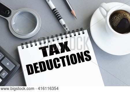 Tax Deduction. Text On White Paper On Gray Background