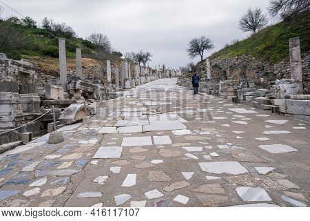 A Man Looking At Historical Curetes Street With Columns And Statues Around In Ephesus Ruins, Histori
