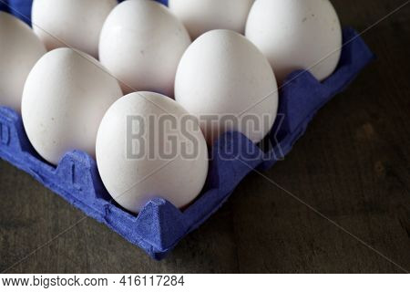 Close-up of eggs in a paperboard.