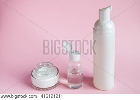 Set Of Cosmetics For Skin Care And Cleansing On A Pink Background. The Concept Of Purity And Body He