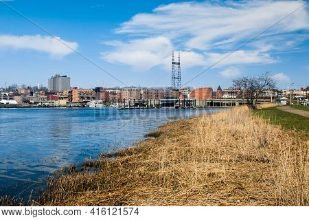 NORWALK, CT,USA  - APRIL 7, 2021: Town skyline viewed  from  Veterans Park near downtown in nice spring day