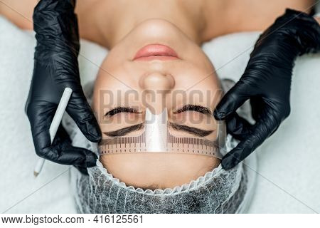 Markup With Ruler On Eyebrows Of Yong Woman During Permanent Make Up.