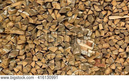Freshly Cut Birch Firewood. Firewood Background. Stacks Of Firewood