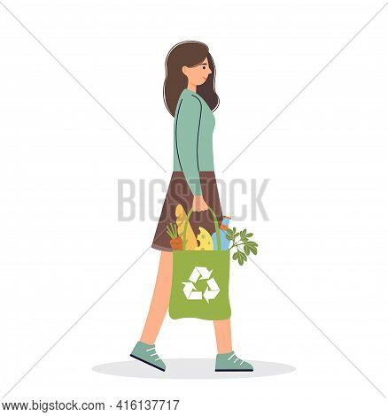 Young Woman Carries An Eco Bag With Groceries. Green Lifestyle. Healthy Lifestyle Concept. Natural E