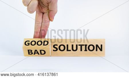 Good Or Bad Solution Concept. Businessman Turns A Block And Changes Words 'bad Solution' To 'good So