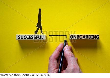 Successful Onboarding Symbol. Wooden Blocks With Words 'successful Onboarding'. Businessman Hand. Bu