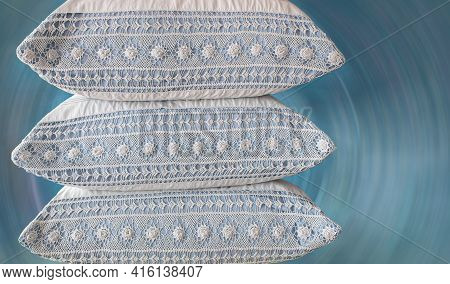 Three Large White Linen Pillows With Crochet Inserts Lay On Top Of Each Other. Blurred Radial Backgr
