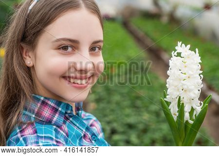 Pleasant Smile. Horticulture. Gardening Activity For Kid. Happy Teen Girl Florist In Greenhouse.