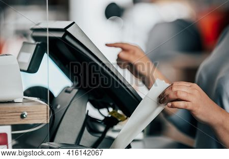 Saleswoman Or Shopgirl Printing Receipt Or Invoice For A Customer, Sales Time, Discount Period, Pos