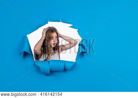 Worried Teen Girl On Blue Background, Copy Space, Problem