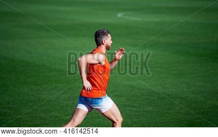 Energetic Athletic Muscular Man Runner Running Outdoor On Green Grass, Sprinter