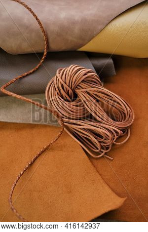 Leather Cord On Natural Brown Leather Background. Accessories Made Of Leather And Cords.leatherworki