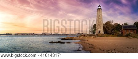 Panoramic View On A Lighthouse On The Atlantic Ocean Coast. Colorful Sunrise Sky Art Render. Taken I