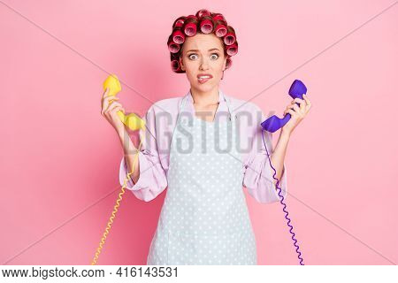 Photo Of Beautiful Worried Person Bite Lip Hold Two Old Phones Isolated On Pastel Pink Color Backgro