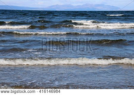 Incoming Tide With Distant Isle Of Arran At Ayr Beach Scotland