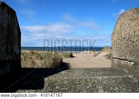 View Of Isle Of Arran From Ayr Seafront Scotland Through A Parapet Wall