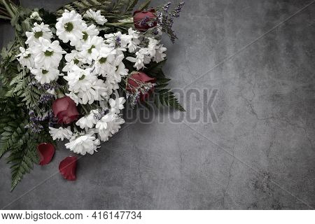 A Beautiful Bouquet Of White Chrysanthemums And Red Roses On A Dark Background. Top View, Copy Space