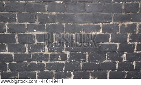 Background With Black Smoked Soot Brick Wall.
