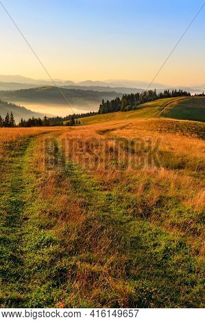 A Road Going Along The Ridge Of A Mountain Hill In The Beautiful Landscape Of The Carpathians In The