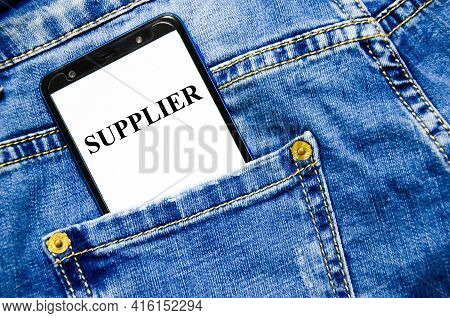 Suppliers - Blue Binder In The Office. Supplier Word Written On White Notepad And Yellow Background.