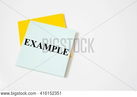 Example Text Written On A White Notepad With Colored Pencils And A Yellow Background. Word