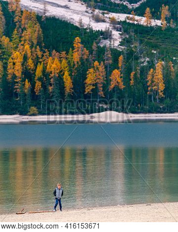 Lago Di Braise, Itlay, Ocrber 20 2021: Young Boy At The Lago Di Braise In The Italian Alps In Autumn